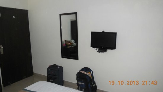 Hotel Delhi Aerocity : View of inside of room from LCD TV side.