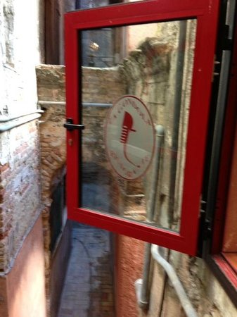 Looking out the open window from the second floor, La Gondola  |  Centro Storico calle de le Ras