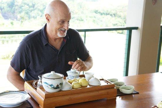 Onomea Tea Company: Mike serving tea in style