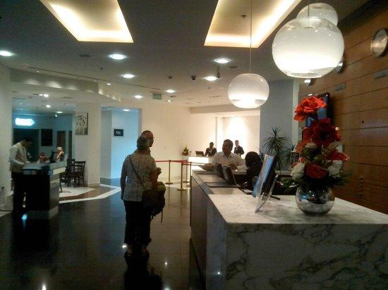 Arabian Park Hotel: hotel lobby with (l to r) deli, bar entrance, emirates checkin, main desk