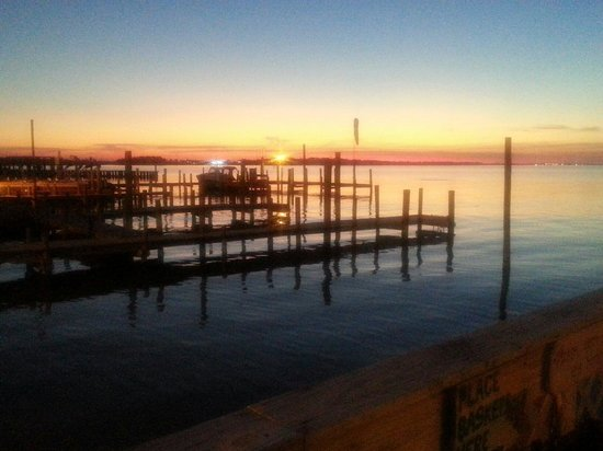 Dewey Destin Seafood: Sunset from our table. Best thing about this place was view.