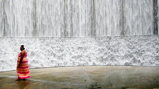a tourist enjoying the water wall in houston tx