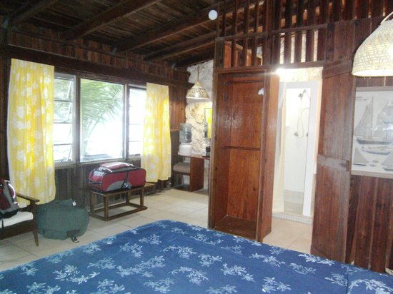 Small Hope Bay Lodge: From the bed - view of the bathroom to the right and the desk area