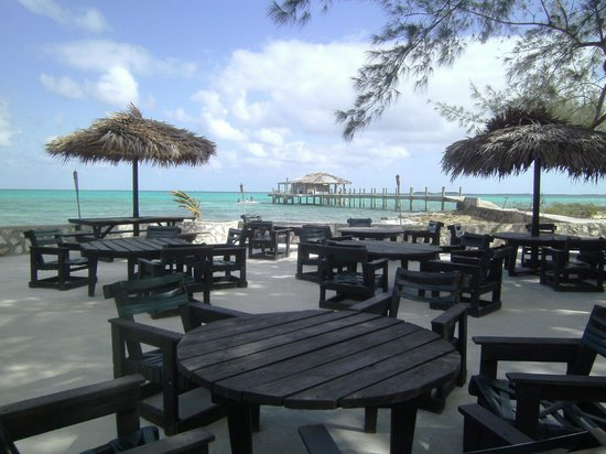 Small Hope Bay Lodge: Outside dining area showing the dive center in the back