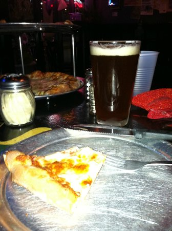 Lupi's Pizza Pies: serving plates are actually small pizza pans....