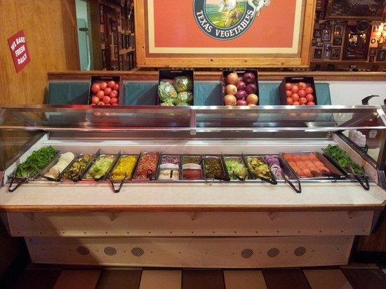 Fuddruckers: Salad toppings bar.