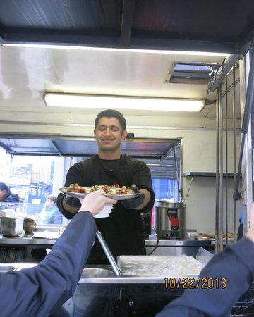 Vancouver Foodie Tours: Sarb ,manager of Soho,delicious butter chicken on homemade naan.