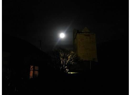 Ballinalacken Castle Country House: Castle at moonlight