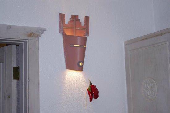 Sun God Lodge: Ceramic light fixture