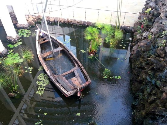 The Boma Nairobi: Backyard basin with old boat
