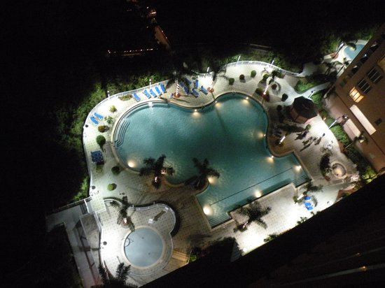 Blue Heron Beach Resort: Pool at night from balcony
