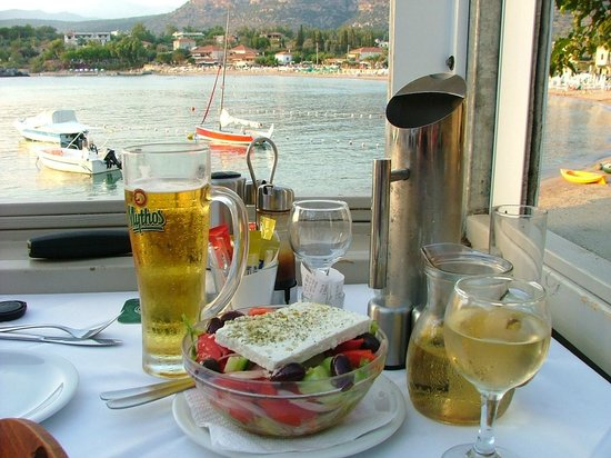Akrogiali : Our Greek Salad with view of Stoupa in the background