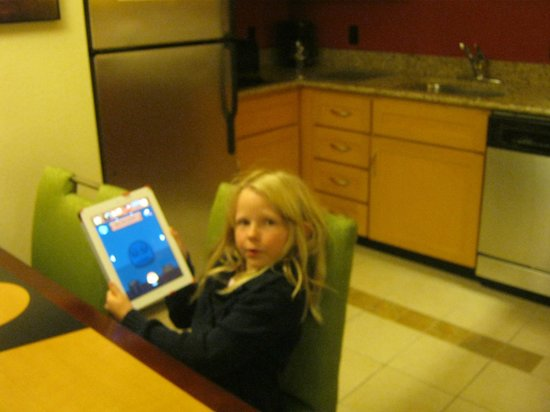 Residence Inn Harrisonburg: kitchen and my daughter with her birthday gift