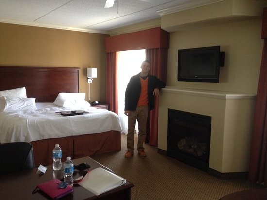 Hampton Inn & Suites Lanett/I-85: View of the king size bed and fireplace, and my boyfriend! Desk is to the left and sofa bed was