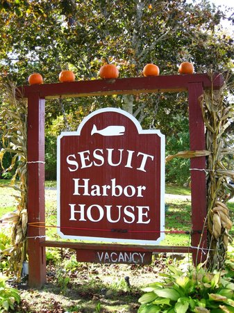 Sesuit Harbor House sign decorated for autumn