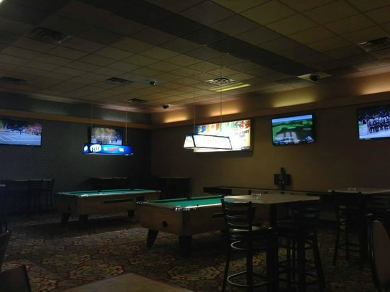 Brimley, MI: Bar area at Kings Club with HDTVs, two pool tables, & shuffle board