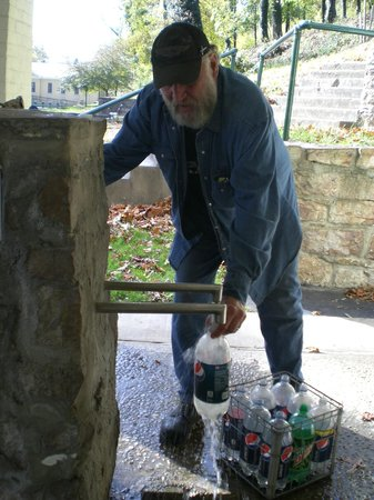 Berkeley Springs State Park: Local man getting free spring mineral water from the Park