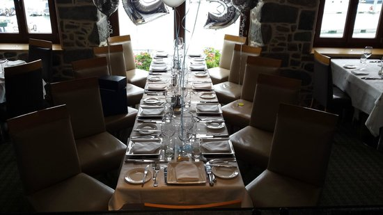 Mora: Our table set out with balloons and sprinkly decorations and view over St Peter Port Harbour