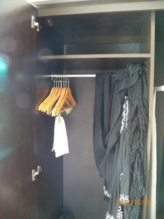 Sleep Inn Manchester Airport: wardrobe in room w/ hangers, ironing board + iron