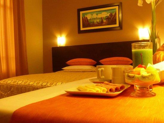Acuario Hotel & Suite: Contamos con  acogedoras habitaciones en las cuales usted podrá disfrutar del mejor confort.