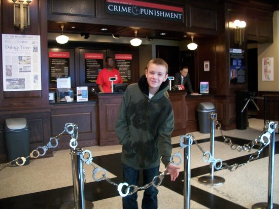 National Museum of Crime & Punishment: Griffin in the entrance to the crime museum..( notice the handcuffs?)