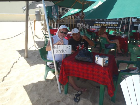 "The Sand Bar: Jaime and Jose with ""no more vendors"" sign"
