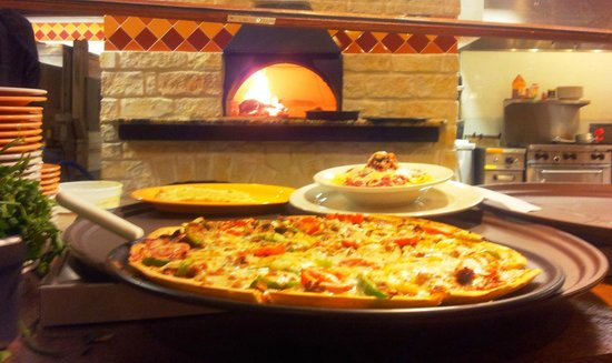 Gucci's Pizza: Firebaked pizza and pasta entrees in our wonderful wood burning oven