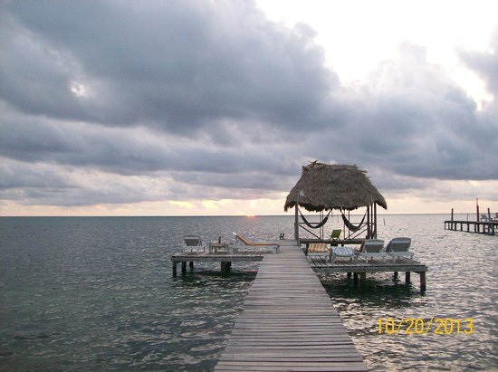 Barefoot Beach Belize : The obligatory picture of the palapa, Beautiful place to relax and watch the waves crash on the
