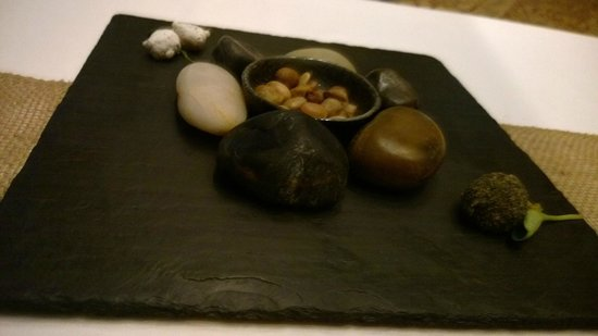 Sixteen: Take a guess what is edible on this place? Hint... it isn't the plate of rocks in the middle.