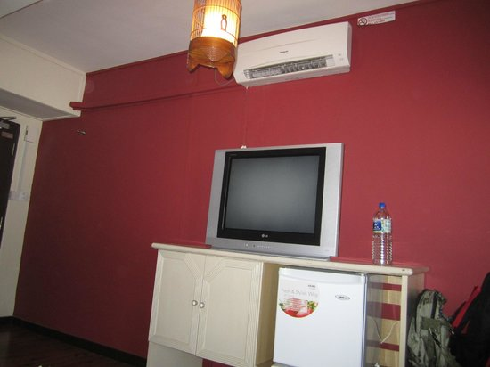 NAK Hotel: Family room - mounted AC, old-new styled lanterns, TV with cabinets and fridge
