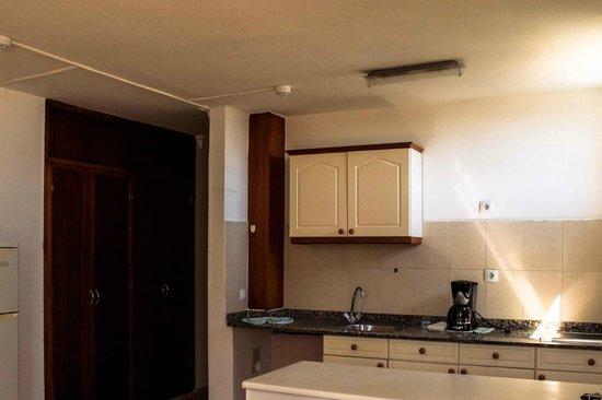 Apartamentos El Palmar: Cuisine américaine