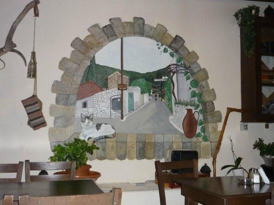 The Hope To Rakadiko Tou Kamari: Mural on the wall at The Hope