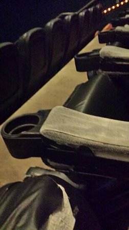 Cinetopia Vancouver Mall 23 : The armrest has all of the leather pulled off !