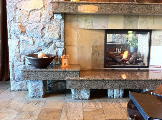 Westin Bear Mountain Victoria Golf Resort & Spa : One of Many fireplaces in hotel lobby and dining/bar areas