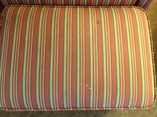 La Quinta Inn Auburn Worcester: Stains on the ottoman that went with the chair