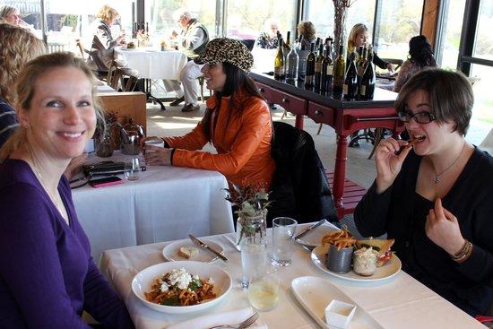 Ravine Vineyard Estate Winery: Pasta and club sandwich in a light, busy restaurant