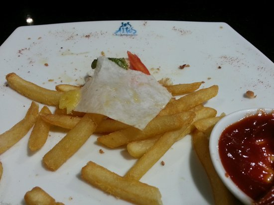 Karolas Restaurant: A piece of paper stuck in my husband's burger