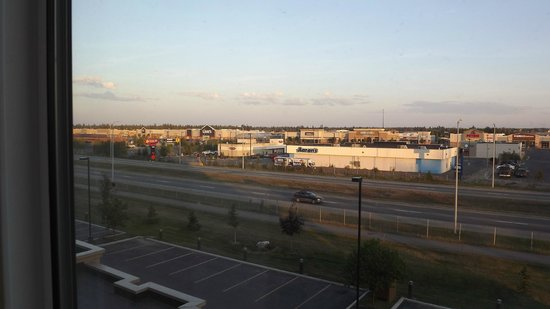 Hampton Inn & Suites Fairbanks: Expressway view from room at 10:11 PM near sunset - August 1, 2013