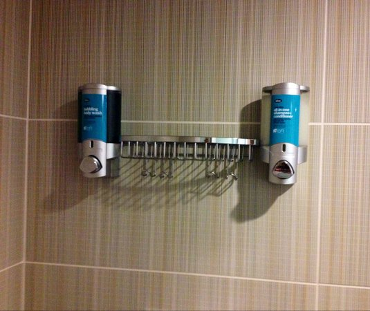 Aloft San Francisco Airport: Bliss products in dispenser in shower.