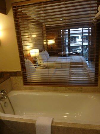 Henann Regency Resort & Spa: Bathroom window looking out to the main bedroom area