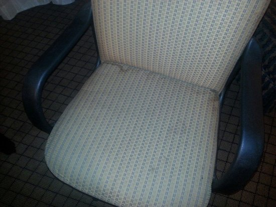 The Hotel Dayton: Stained chair at desk