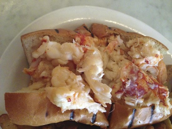 Neptune Oyster: Hot butter lobster roll close up