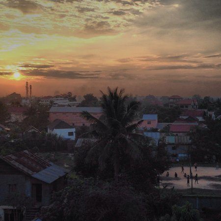 The Cashew Nut Villa.: Rooftop view at sunset from deck at cashew nut in siem reap