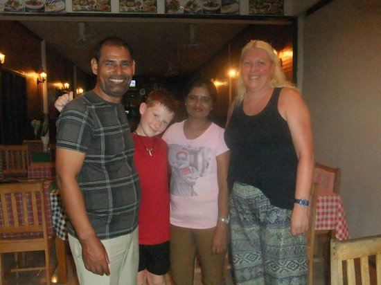 Akbar Indian and Thai Restaurant: Raj and his wife with my son John and me ….