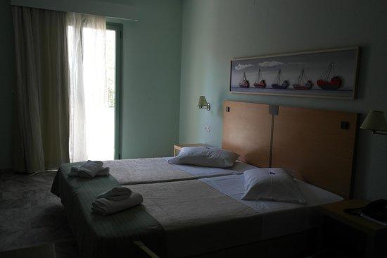 Hotel Erato : Seng og rom