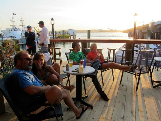 Captain Bill Bunting's Angler: Friends enjoying music, food and sunset