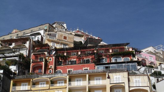Hotel Miramare: View from the harbor looking up at the hotel (reddish bld)