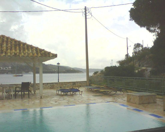 Marika: View from veranda with pool and beach