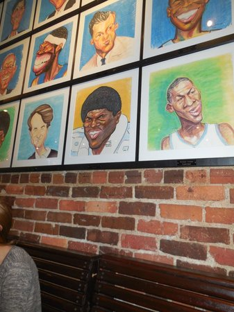 Spanky's Restaurant : One of several walls covered with caricatures of UNC alumni