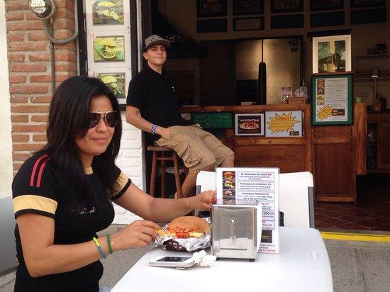 BC Burgers: Beautiful Mexican girl enjoying one BC Burger